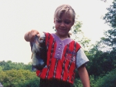 Sheena catching bass at a young age